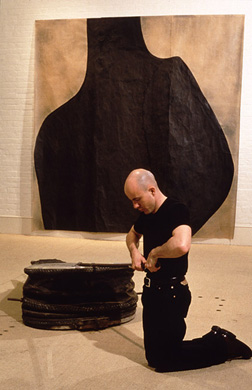 'Breathe' (installation view) 1997. Wall, acrylic and wax on japanese paper, 300x300cm. Floor, leather and metal, 27x110x190cm. Sh Ervin Gallery, Sydney for Australian Perspecta. Performer: Mark Hughes