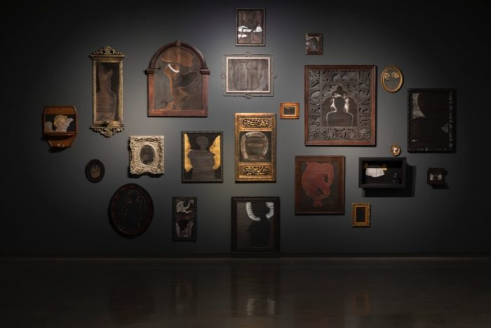 installation of 'The Ancestors' 2014 acrylic on wooden panels, objects, found frames, dimensions variable